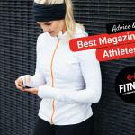 Athlete woman reading a magazing on her phone