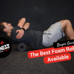 Man using a foam roller on the ground in the gym