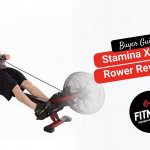 man extended on a red rowing machine