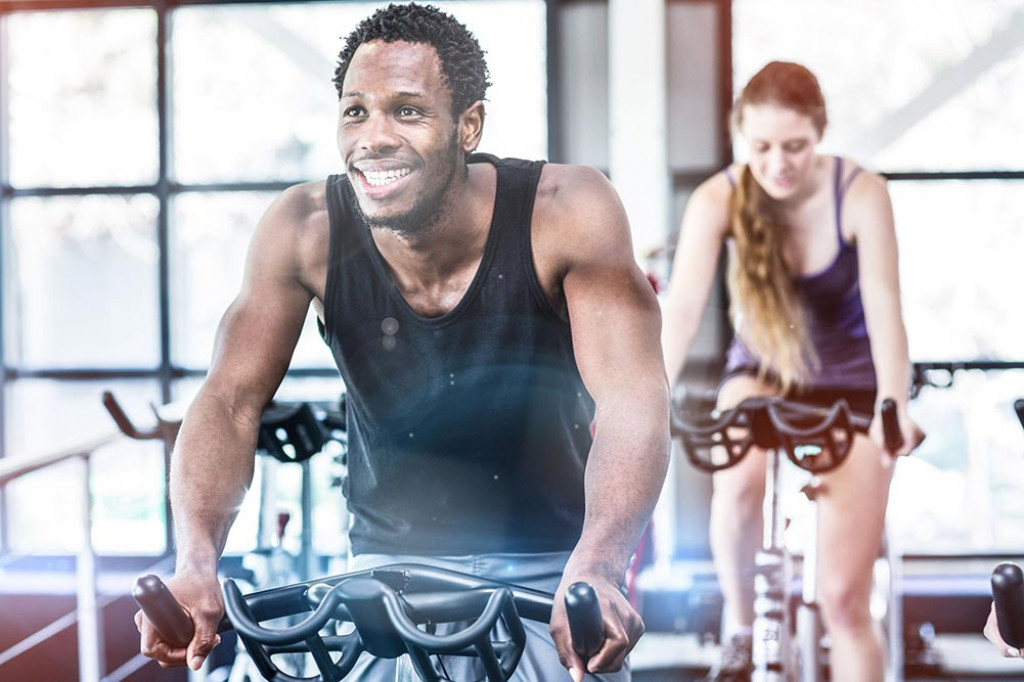 sweaty strong male on a spin bike