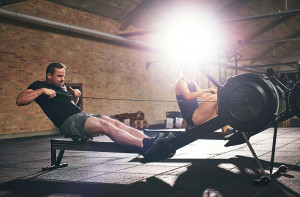 Man using a rowing machine in a gym