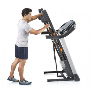 male folding and moving the T 6.5 s treadmill