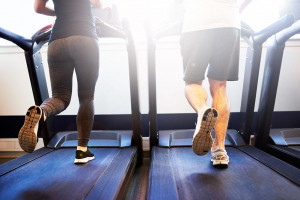 a man and woman running on parallel treadmills