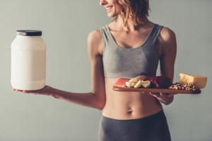 Healthy woman looking at supplement