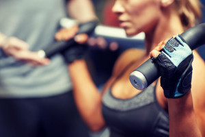 woman in the gym wearing gloves