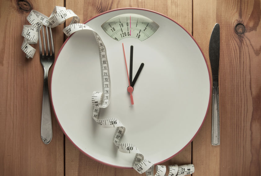Plate with clock hands pointing to bathroom scales display