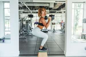 woman doing a weighted squat