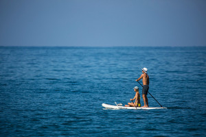 Couple stand up paddle boarding
