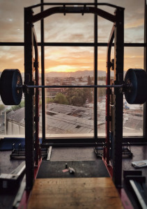 gym equipment with sunset behind