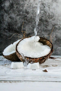 coconut water pouring over coconuts