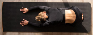 top view woman stretching mat