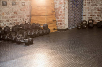 Dumbbells and kettlebells on gym floor