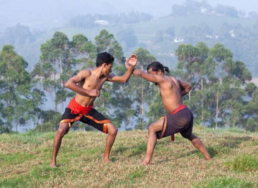 Indians practicing martial arts