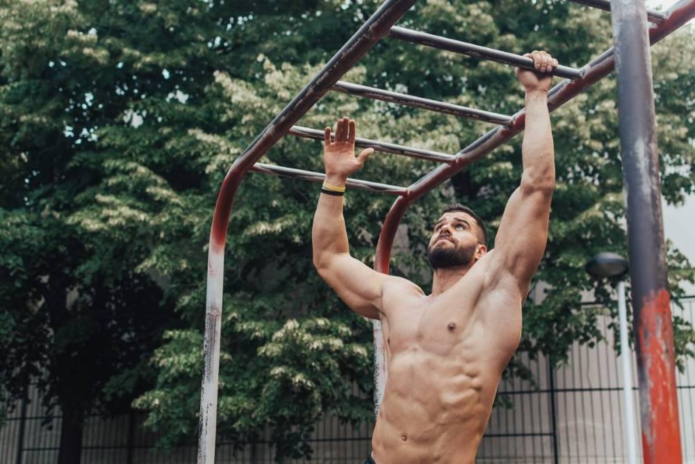Man doing pull-ups outside