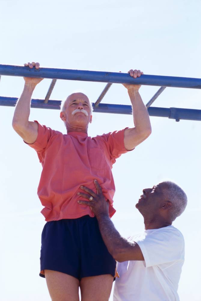 Older man helping another chin up