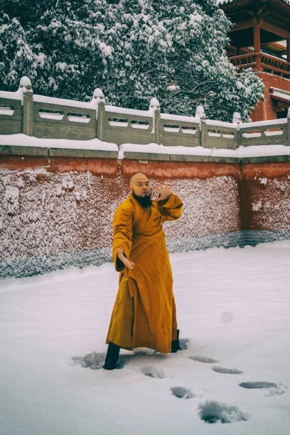 Shaolin monk training in snow