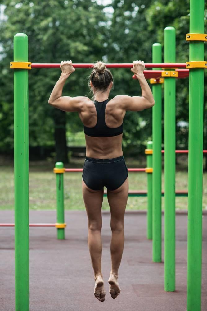 woman hanging on bar