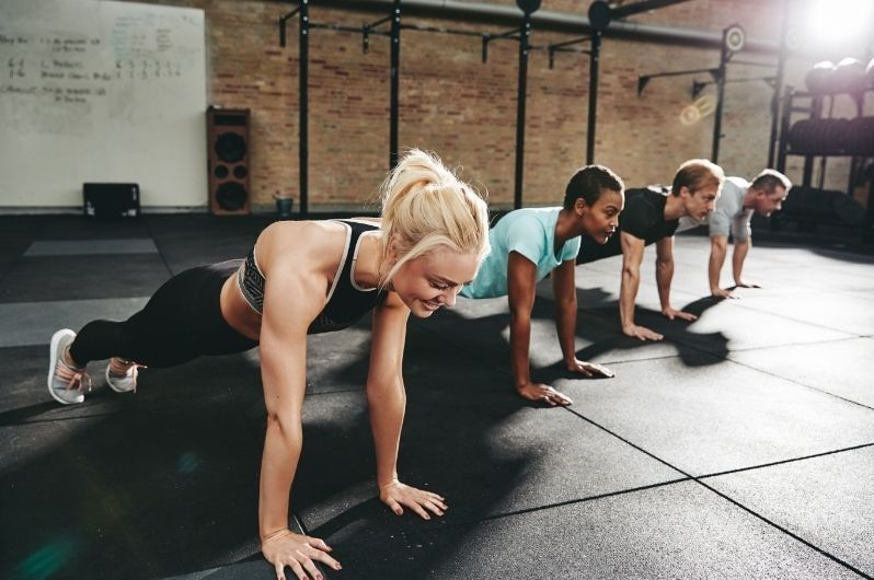 Healthy group of people doing push ups