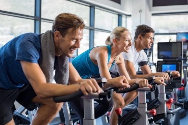 Beginners enjoying an exercise bike class