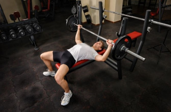 Young man doing bench press at the gym
