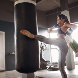 girl kick the bag by her leg