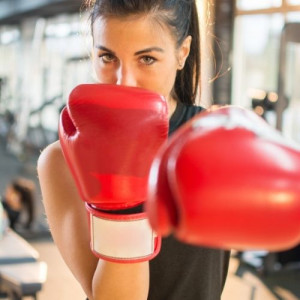girl with red gloves for boxing