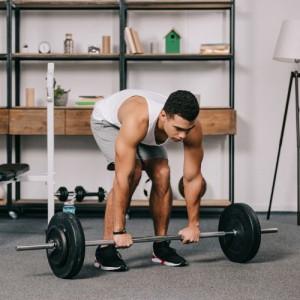 man lifting weight inside home