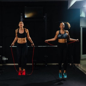 two girls jumping rope in the gym