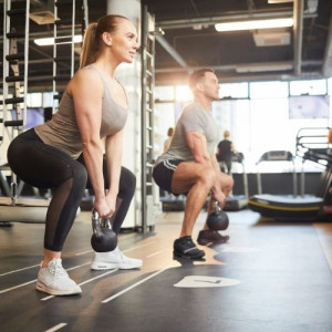 couple doing squats with weight