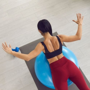 woman doing back extension on the ball