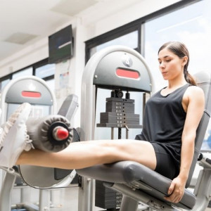 woman in the leg extension machine